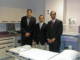 Dr. John Holt And Dr. Anil Tumbapura And Dr. Hirendra Doshi Standing In Hospital